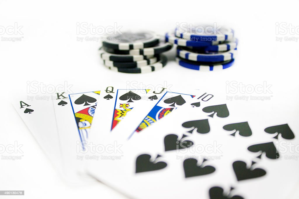 Playing Cards and Poker Chips Isolated on White Background stock photo