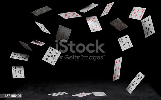 playing cards fall on black table on a dark background