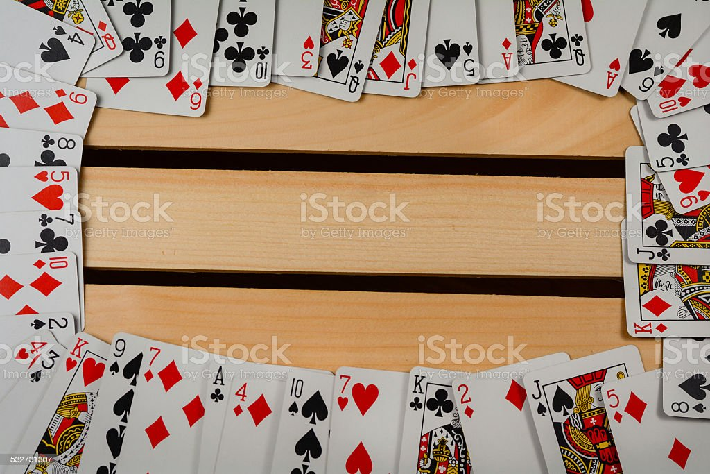 Deck of playing cards arranged around a wooden platform. Great for...