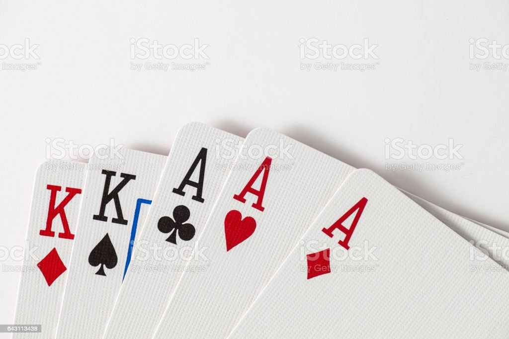 Playing Cards full house, kings and aces with space at top stock photo