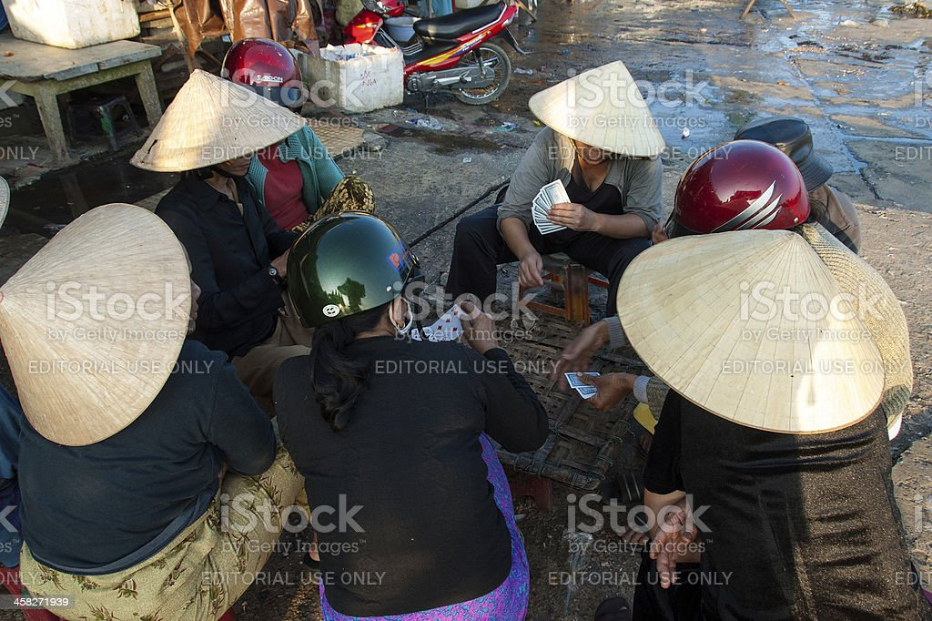 Playing cards in the fish market of Hoi An, Vietnam royalty-free stock photo