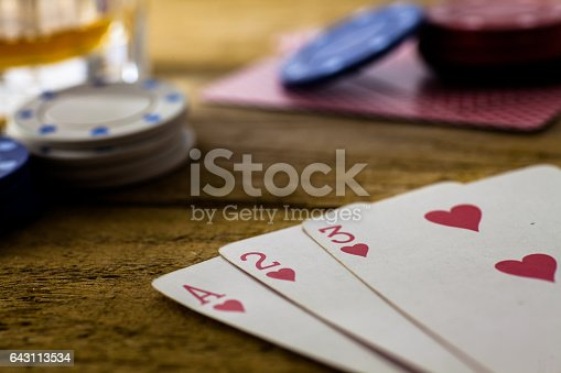 istock Playing Cards on wooden table 643113534