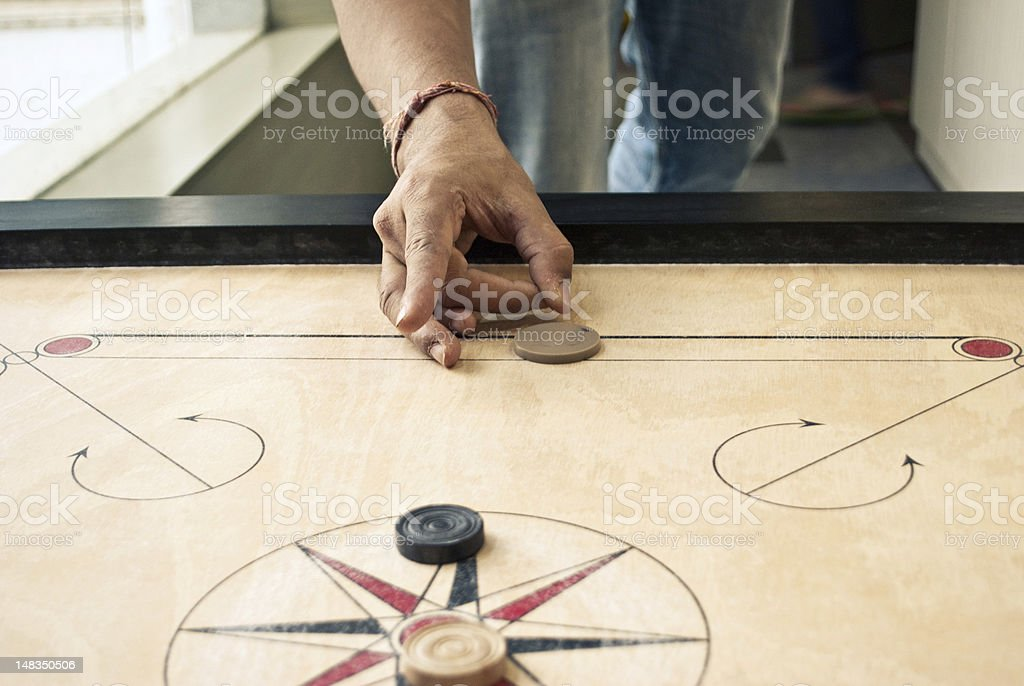 playing carrom stock photo