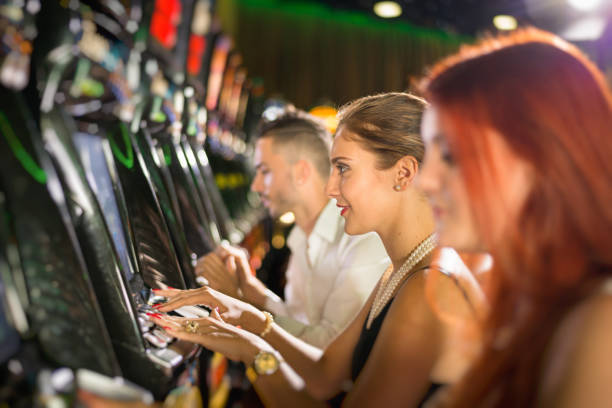 Playing Casino Slot Machines stock photo