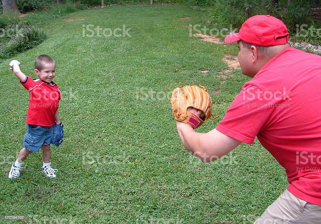 Playing catch with Dad stock photo