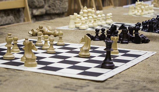 Playing chess in a game on the street, wit game detail