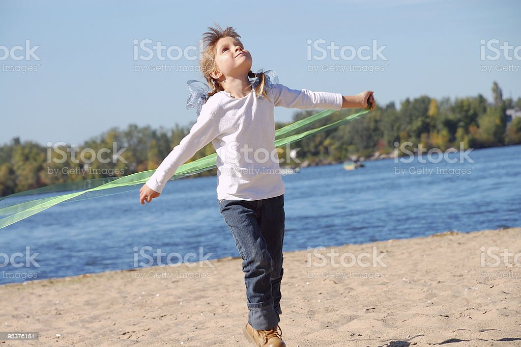 playing child on the beach royalty-free stock photo