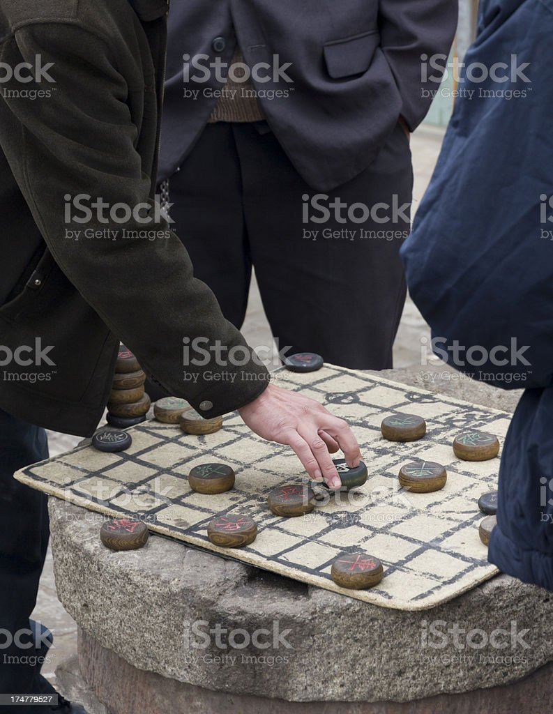 Playing Chinese board game royalty-free stock photo