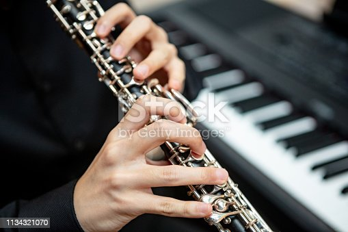 Close-up of unrecognizable man playing clarinet