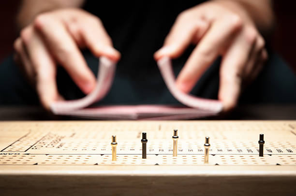 playing cribbage - kellyjhall stock pictures, royalty-free photos & images