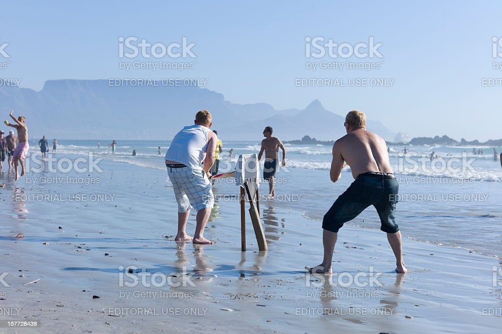 Playing Cricket on Bloubergstrand, Cape Town, South Africa. stock photo