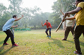 istock Playing Cricket - stock images 1127962409