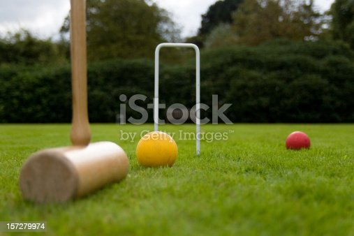Playing croquet on an English lawn