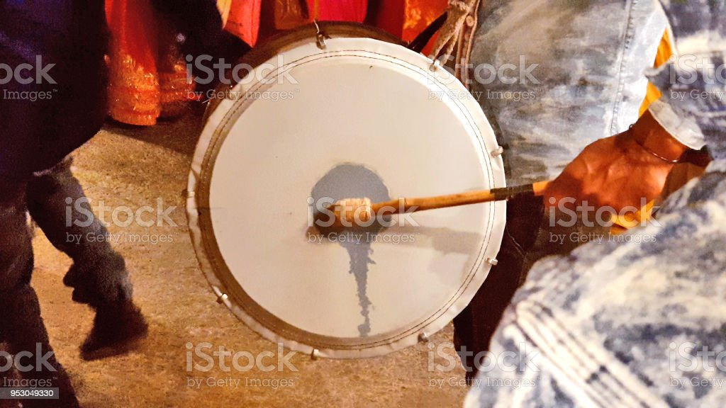 Playing Dhol or drum stock photo