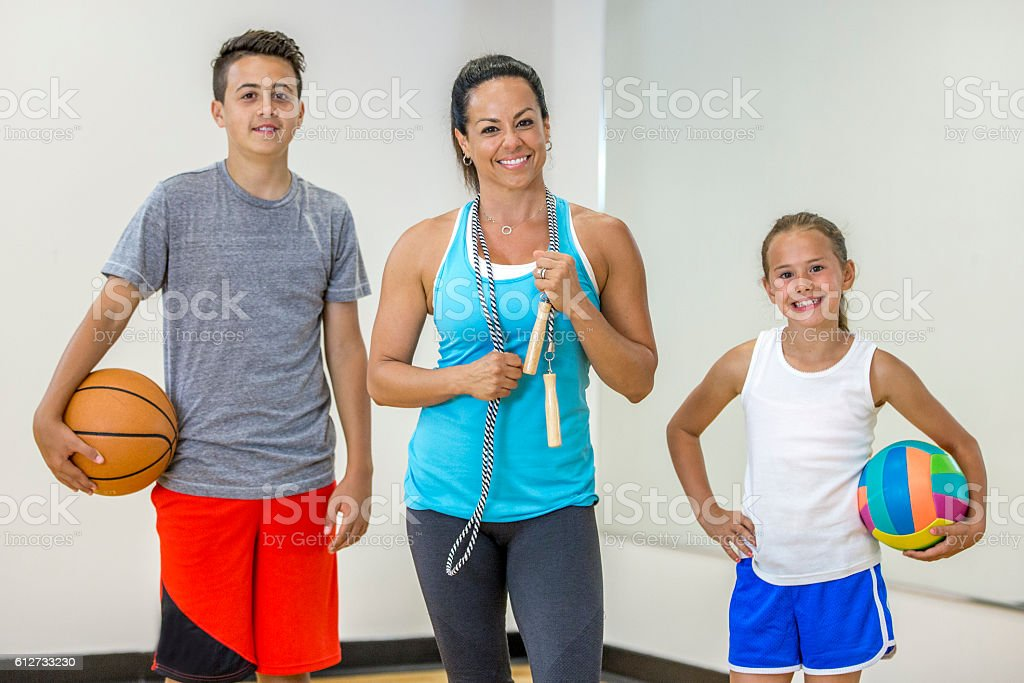 Playing Different Sports at the Gym stock photo