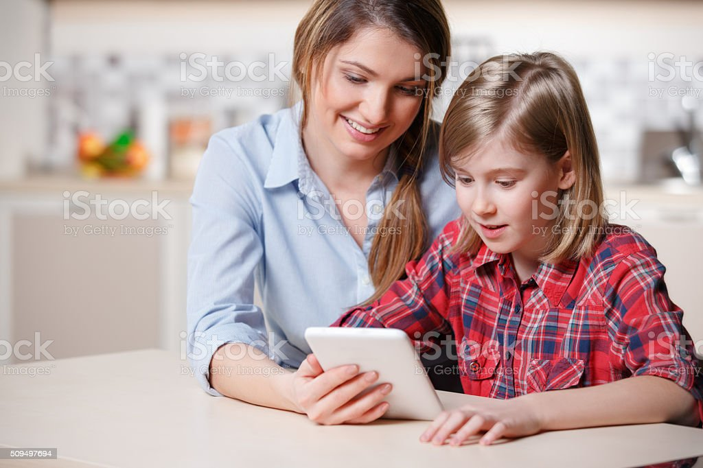 Playing digital tablet stock photo