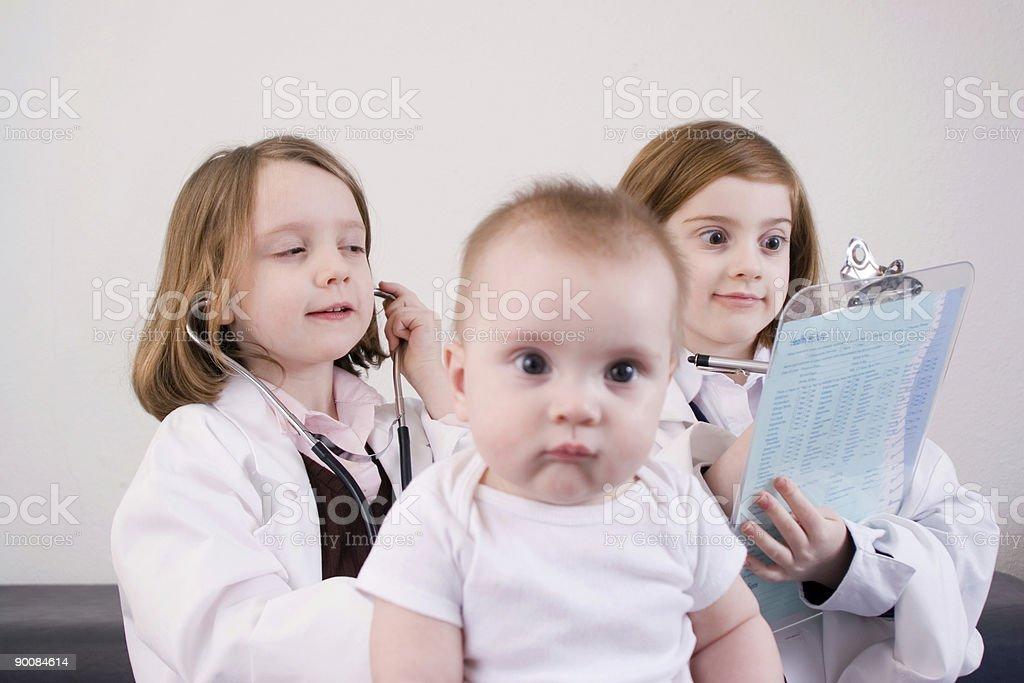 Playing doctor stock photo