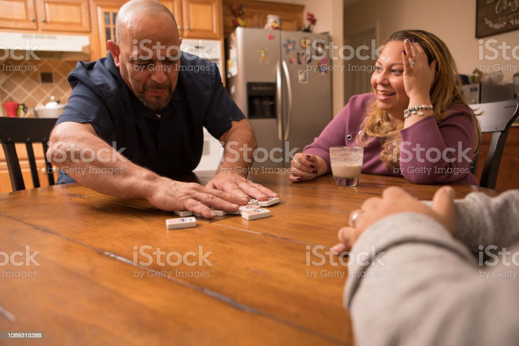 playing dominoes stock photo