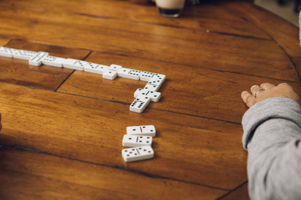 playing dominos stock photo