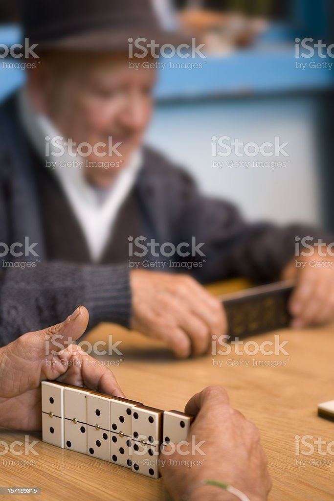Playing Dominos royalty-free stock photo
