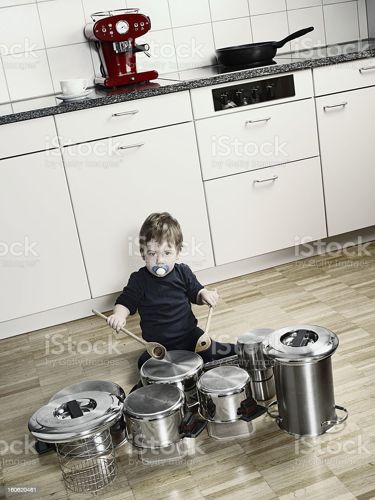 Playing drums with pots and pans stock photo