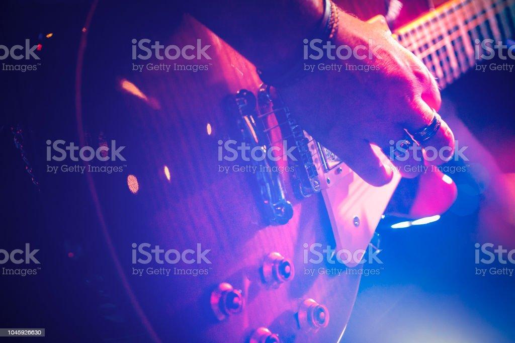 Playing e-guitar stock photo