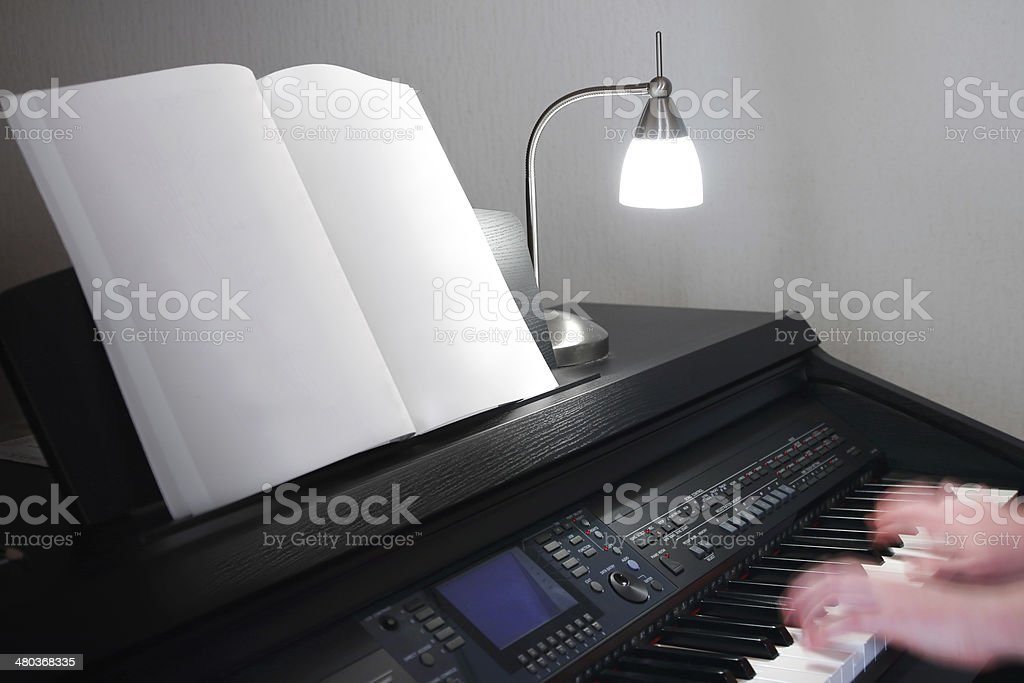 Playing electronic piano stock photo