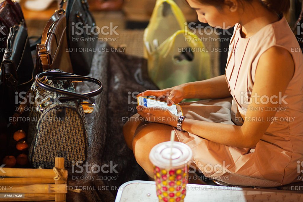 Playing facebook on mobile stock photo