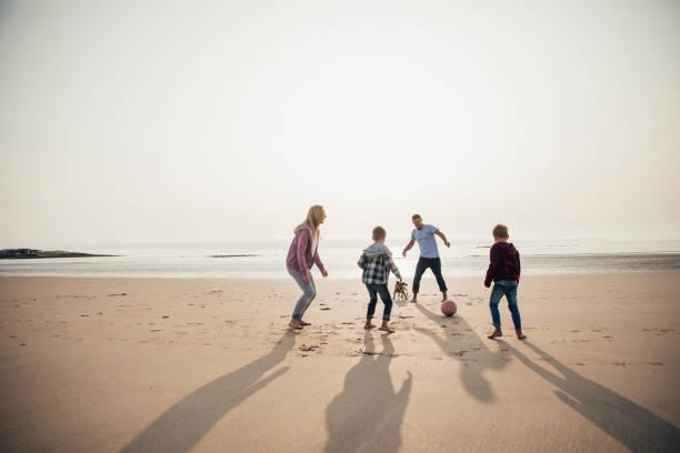 Playing football at the beach picture id932372370?b=1&k=6&m=932372370&s=612x612&w=0&h=ynvceclyuajy7nstxko9wltzoqb61kl865pfukhnbuc=