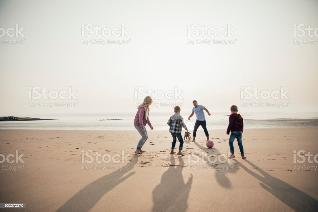 Playing Football at the Beach stock photo