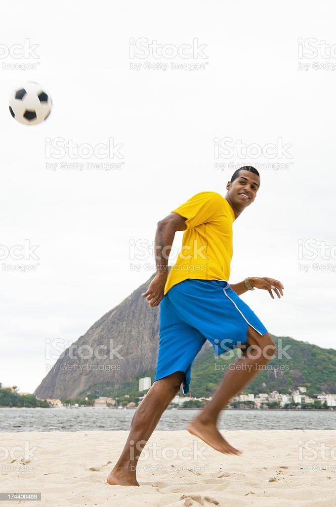 Playing Football on Praia do Flamengo, Rio, Brazil. stock photo