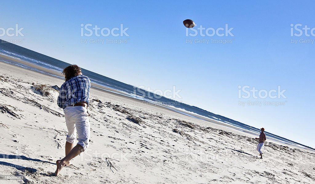 Playing football on the beach royalty-free stock photo