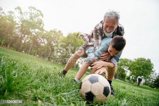 639800036istockphoto Playing Football With Grandad 1153606230