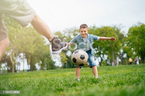 639800036istockphoto Playing Football With Grandad 1154023692