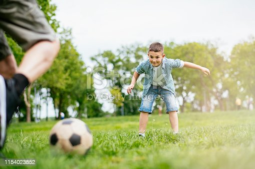 639800036istockphoto Playing Football With Grandad 1154023852