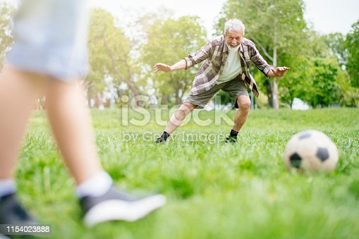 639800036istockphoto Playing Football With Grandad 1154023888
