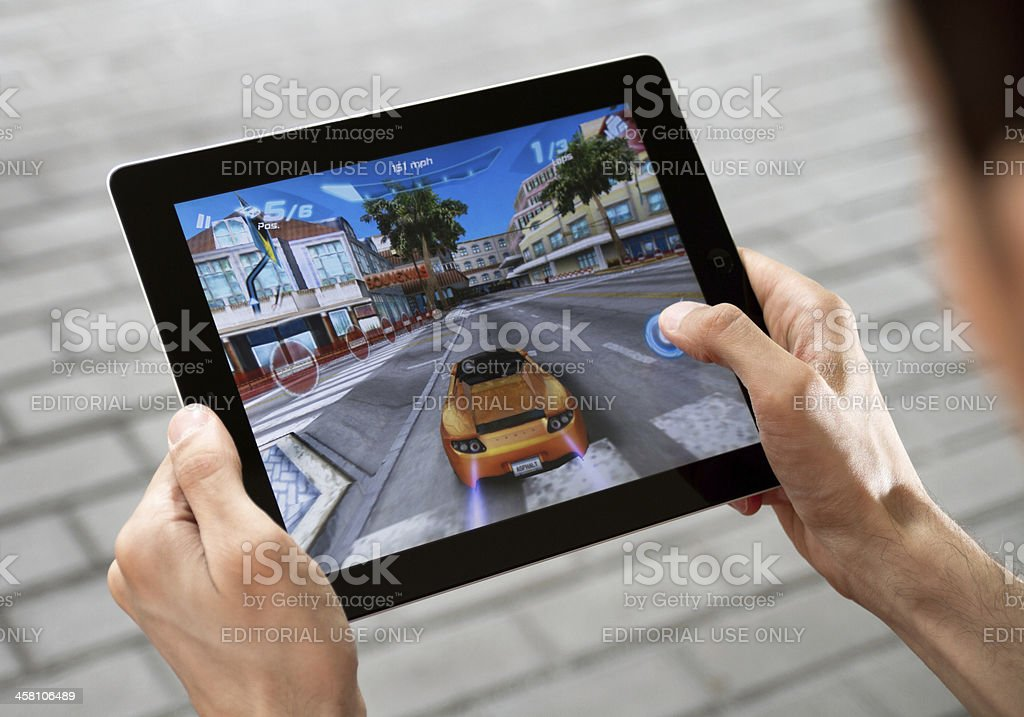 Playing Game on Apple Ipad2 stock photo