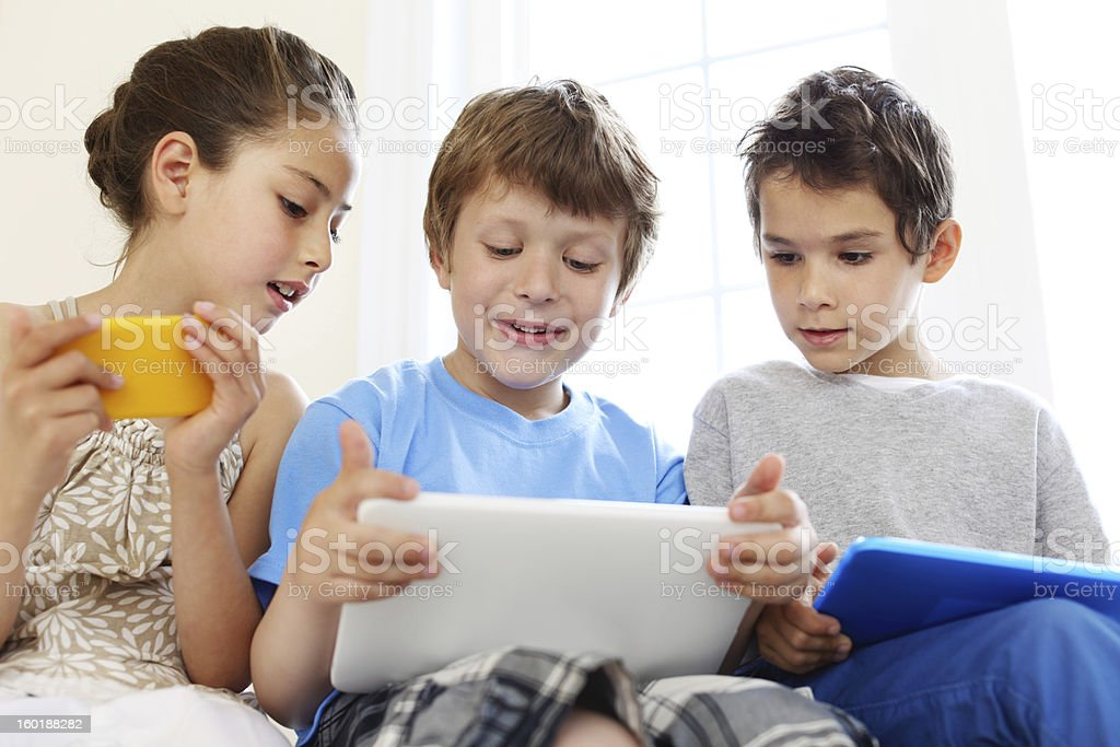 Playing games on tablet royalty-free stock photo