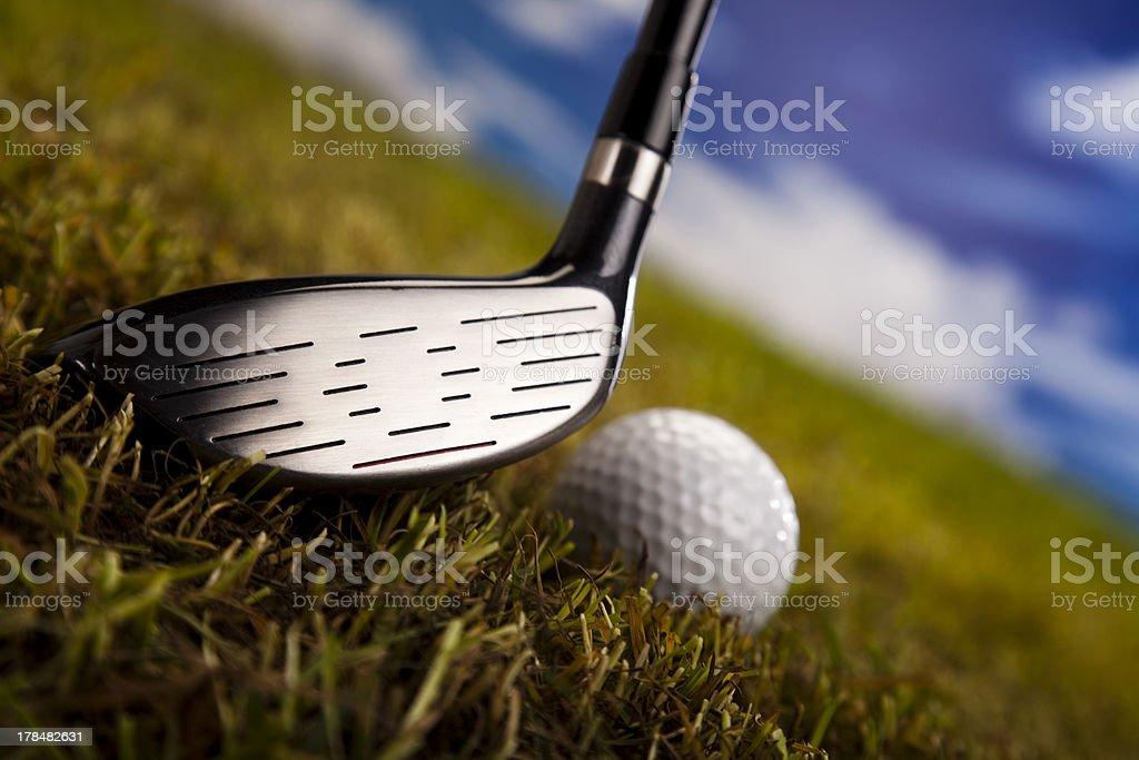 Playing golf, ball on tee royalty-free stock photo