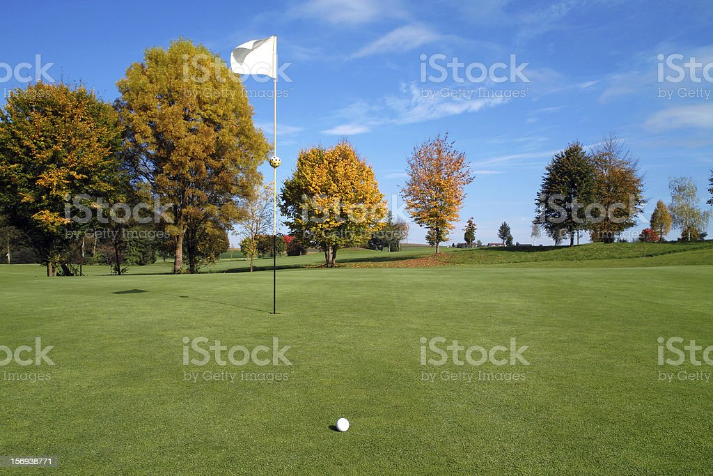 Playing golf in fall royalty-free stock photo
