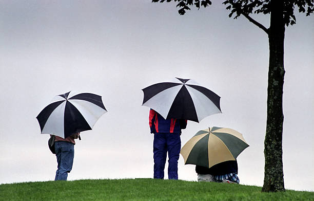 Playing Golf in the rain stock photo