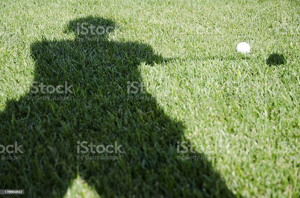 Playing golf royalty-free stock photo