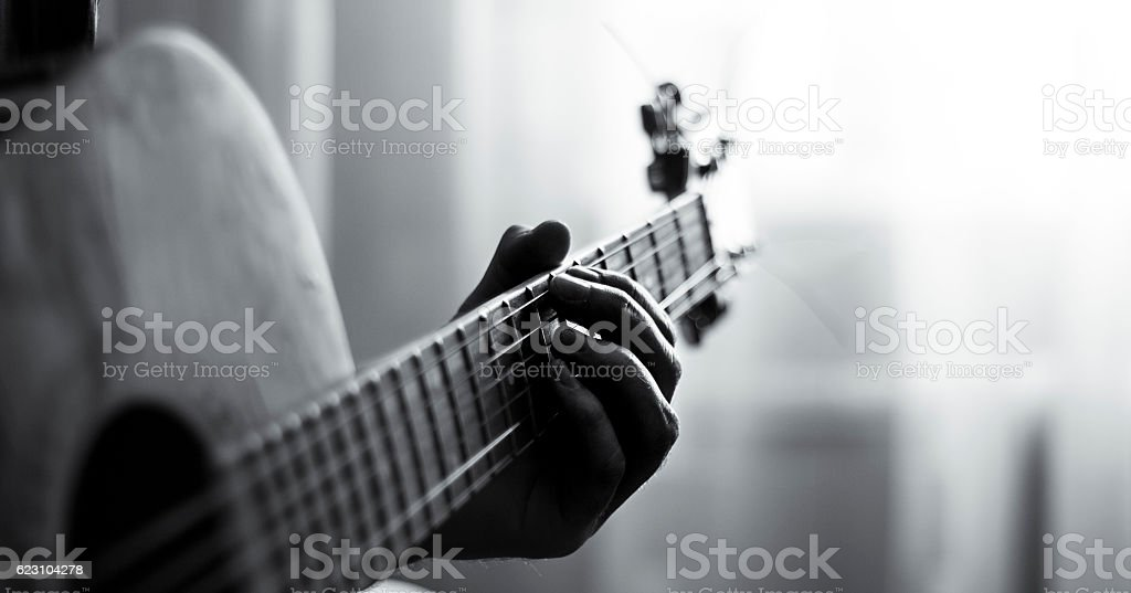 Playing guitar black and white stock photo