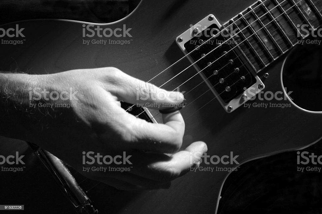 Playing Guitar in Black and White stock photo