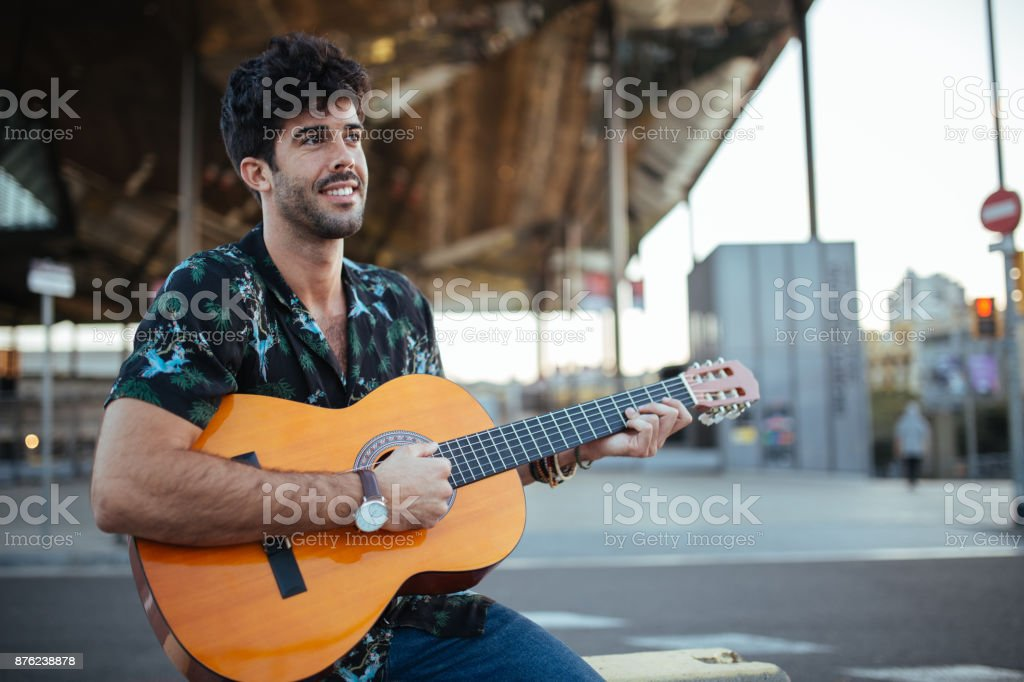 Playing guitar in city stock photo