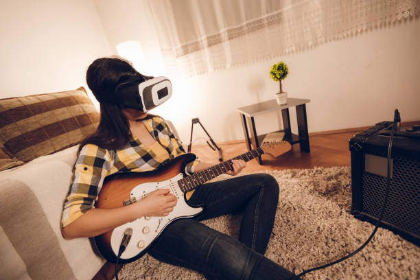 playing guitar in virtual reality - musicians singers during lockdown foto e immagini stock
