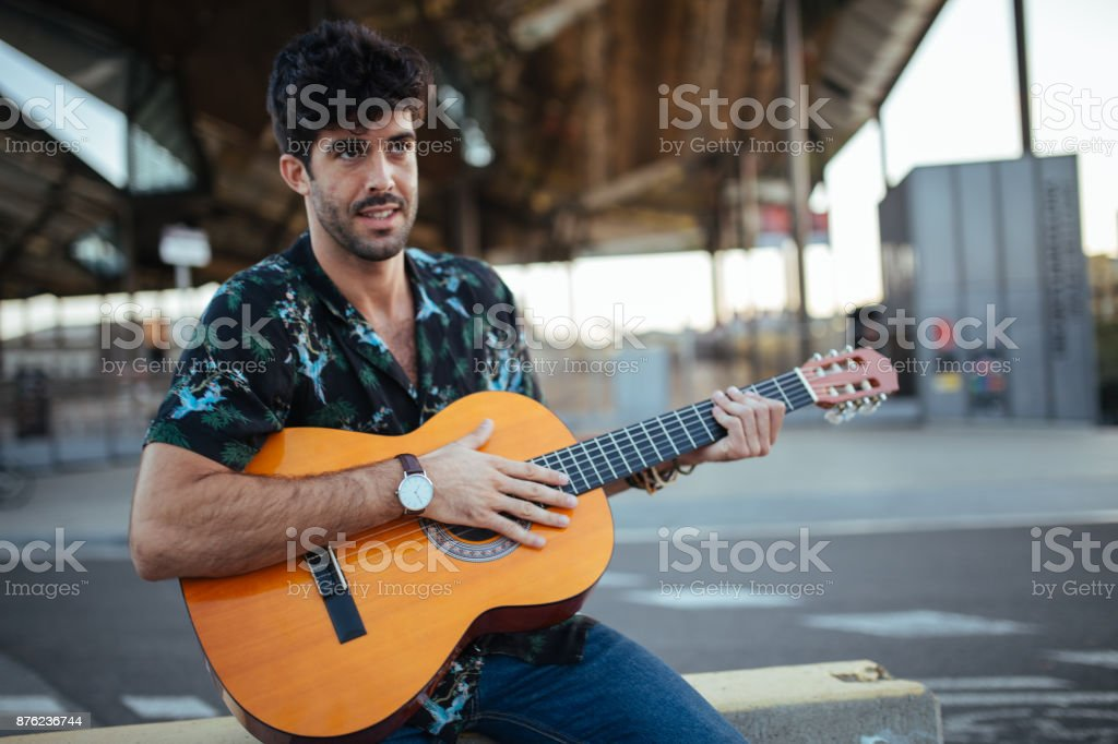 Playing guitar on the street stock photo