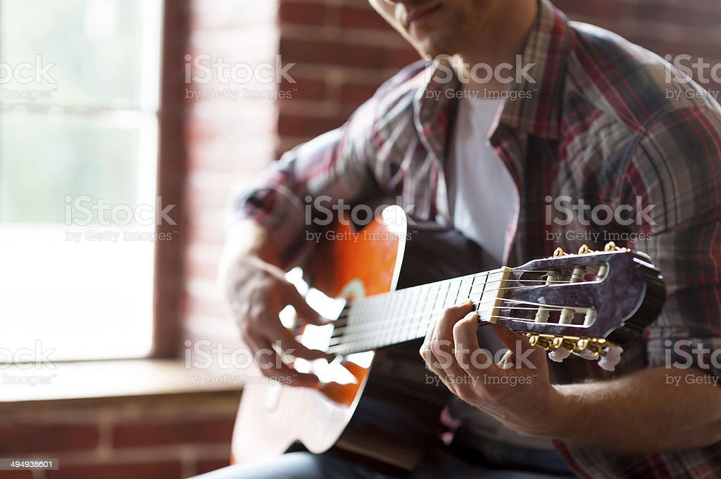 Playing guitar. royalty-free stock photo
