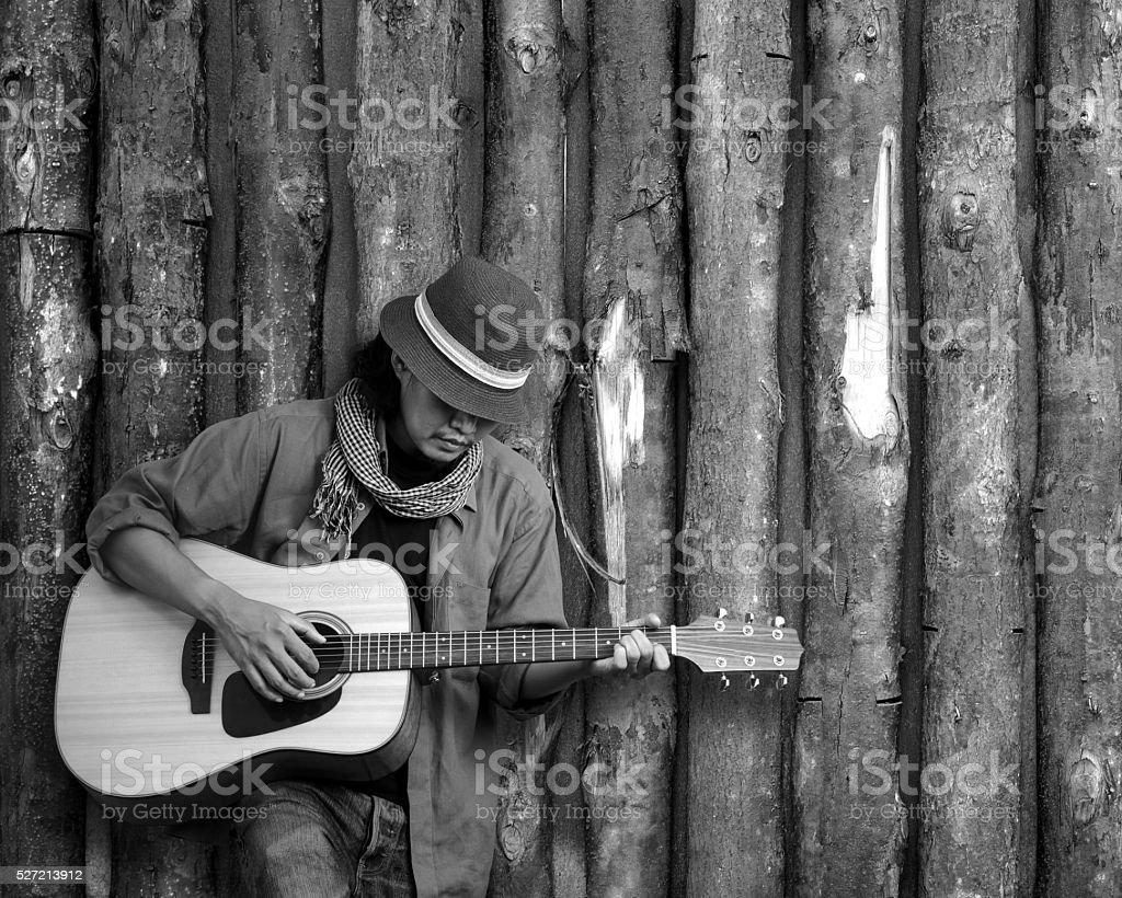 Playing guitar stock photo