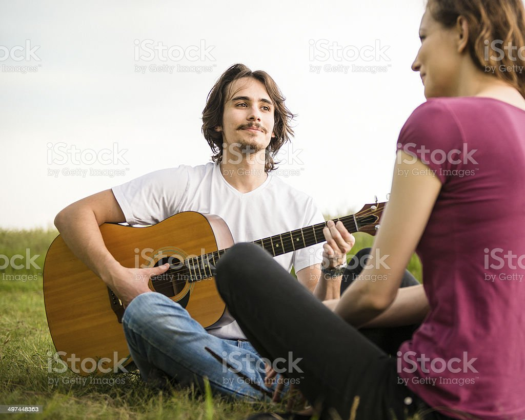 Playing guitar - romantic couple royalty-free stock photo